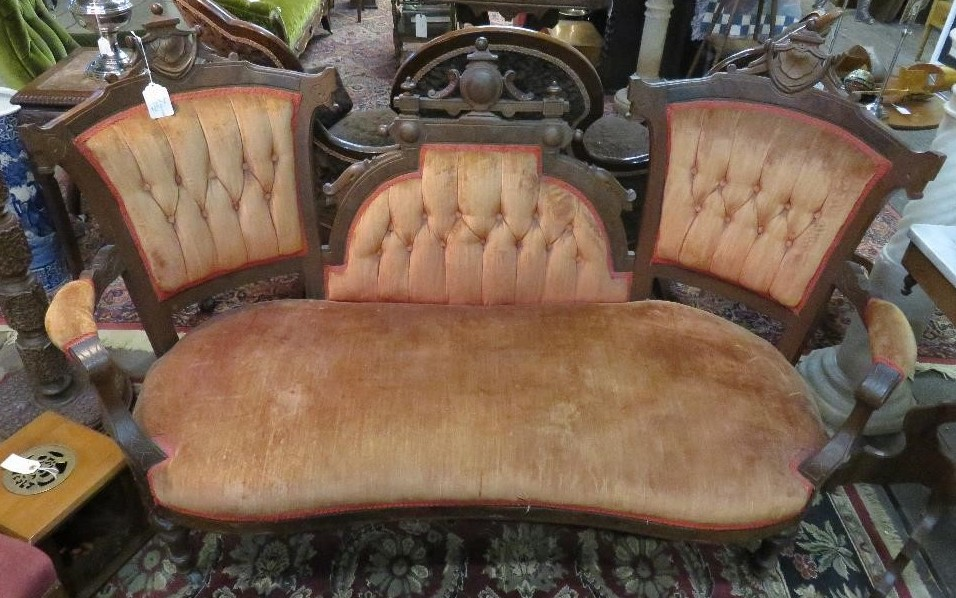 Victorian walnut loveseat with tufted upholstery